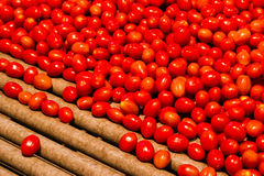 Lots of Cherry tomatoes. Cherry tomatoes ready to be packed with a machine Stock Image
