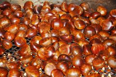 Lots chestnuts in pot, food background Royalty Free Stock Photos