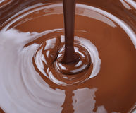 Lots of chocolate falling Stock Photography