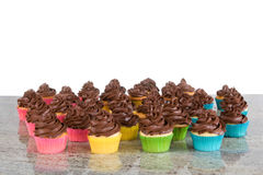 Lots of chocolate frosted cupcakes stock photo