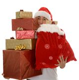 Lots of christmas gifts by santa Royalty Free Stock Photo