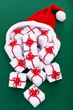 Lots of christmas present flowing out of santa's hat Royalty Free Stock Images
