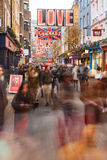 Lots of Christmas shoppers on Carnaby Street, London. Royalty Free Stock Images