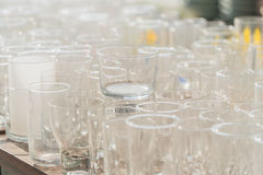 Lots of clean empty glasses of drinks on the bar in a nightclub. Stock Photos