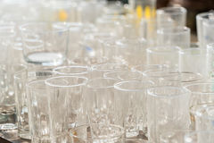 Lots of clean empty glasses of drinks on the bar in a nightclub. Royalty Free Stock Image