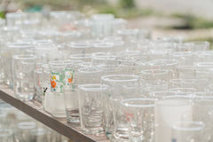 Lots of clean empty glasses of drinks on the bar in a nightclub. Stock Image
