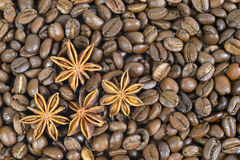 Lots of coffee beans. And four anise stars. Pattern. Royalty Free Stock Image