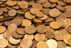 Lots of coins. Dropped on flat surface - angled view, texture of coins Stock Images
