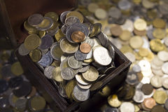 Lots of coins, pot of money Stock Images