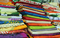 Lots of colored cloth tablecloths for sale in the city market Stock Image
