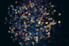 Lots of colorful bokeh on a dark background. Fireworks is not in focus.  Royalty Free Stock Photos
