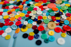 Lots of Colorful Buttons on Blue Wood. Beautiful, colorful buttons on a blue wooden background Stock Image