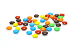 Lots of colorful candies. Spread on white background Stock Image