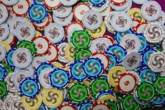 Lots of colorful casino playing chips top view stock image
