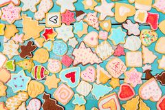 Lots of colorful christmas cookies with frosting and royal icing. Seasonaly greeting card or postcard stock photography