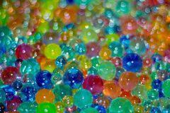 lots of colorful glass balls of different sizes as a background with bokeh stock image