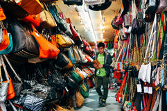 Lots of colorful hand bags at Canal street in Manhattan. royalty free stock images
