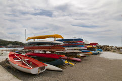 Lots of colorful kayaks on the beach Royalty Free Stock Photo