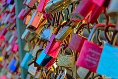 Lots of colorful love padlocks, selective focus, full frame Stock Image
