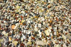 Lots of colorful pebbles from a sea shore for backgrounds stock photography