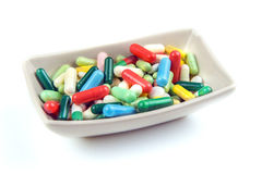Lots of colorful pills on white background Stock Photography