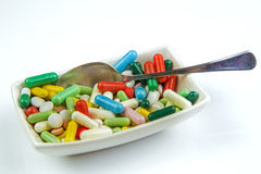 Lots of colorful pills on white background Stock Photos