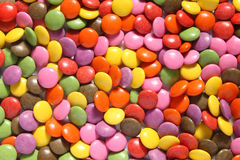 Lots of colorful smarties. A close up of lots of colorful smarties Stock Image