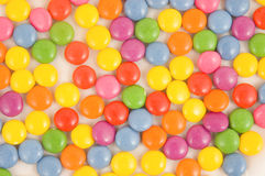 Lots of colorful smarties on white. Background royalty free stock image