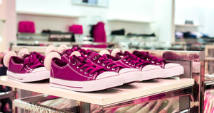 Lots of colorful sneaker shoes on sale Royalty Free Stock Image