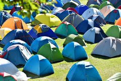 Lots of colorful tents in a camping Royalty Free Stock Images