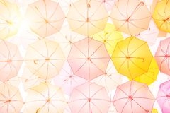 Lots of colorful umbrellas flying in sky over city street during. Summer festival. Fun and happy background concept. Vintage and retro threme Stock Photography