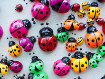 Lots of colorful wooden ladybugs. Stock Images