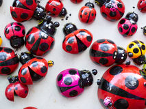 Lots of colorful wooden ladybugs. stock photography