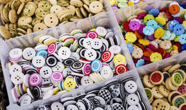 Lots of colourful buttons. Buttons of all sorts at a market stall Royalty Free Stock Photos