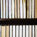 Lots of colourful thick open books stand on a dark background. Ready to read paper shop bookshelf bookstore cardboard education fiction folder information royalty free stock images