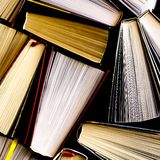 Lots of colourful thick open books stand on a dark background. Ready to read paper shop bookshelf bookstore cardboard education fiction folder information royalty free stock photography