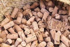Lots of cork stoppers for wine bottles. In a wicker basket Stock Photography