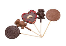 Lots of delicious chocolate candy on stick Royalty Free Stock Photos
