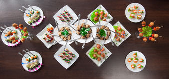 Lots of delicious nourishing appetizers on table Royalty Free Stock Photography
