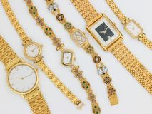 Lots of designed gold watches stock images