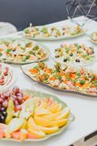 Lots of different food at a party ,close up, sandwiches with meat and fruits stock photo