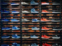 Lots of different sneakers on the showcase on market. Image of sport shoes on shop-window. In a store Royalty Free Stock Image