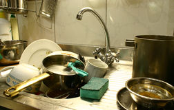 Lots of dirty dishes. Dirty dishes in the kitchen's sink ready to start washing Royalty Free Stock Image