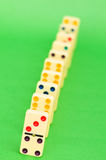 Lots of dominoes on the green Royalty Free Stock Image