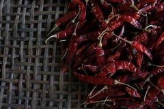 Lots of dried chilli. Lots of dried chilli on threshing basket Stock Photo