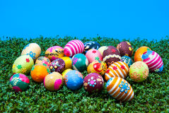 Lots of easter eggs on cress. Pile of handmade easter eggs placed on cress. Some eggs are covered by cotton string in different colours. Additional decorative Stock Photography
