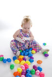 Lots of Eggs. A young with lots of Easter eggs stock photo