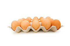 Lots of eggs in the carton isolated. On white Royalty Free Stock Image