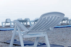 Lots of empty deck chair and blankets on the beach Stock Images