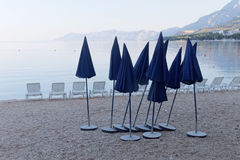 Lots of empty deck chair and many parasol Stock Images